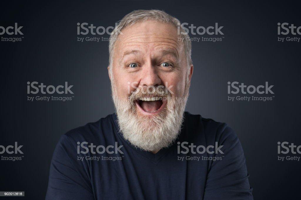 Gray beard happy old man stock photo