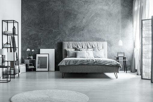istock Gray bedding and soft headboard 830503928
