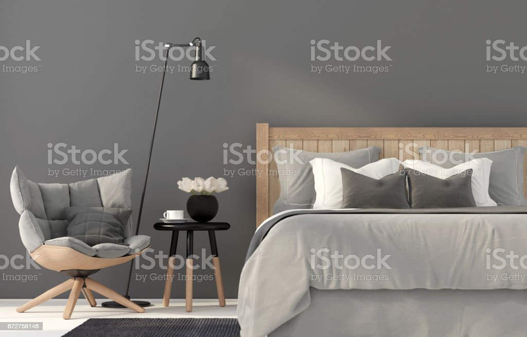 Gray bedroom with a wooden bed stock photo
