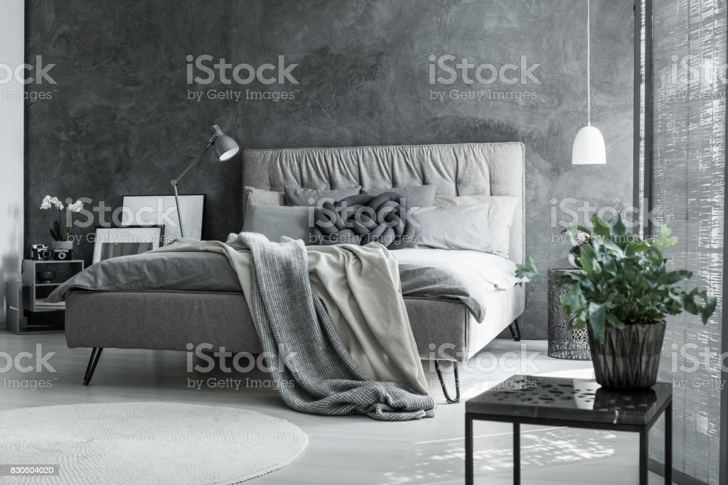 Gray bedroom with handmade pillow stock photo