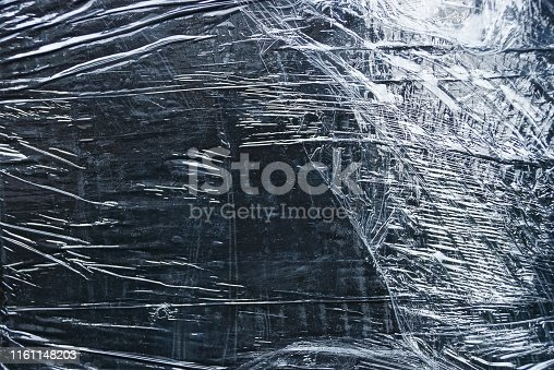 istock gray black plastic texture from a crumpled piece of cellophane 1161148203