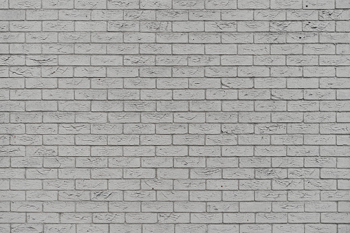 905087856 istock photo Gray brick wall background. Old gray brick wall texture background. 1220946622
