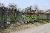 istock gray broken wooden plank fence in green grass on a rural street 1145673104