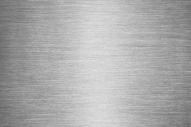 Gray Brushed Metal Texture Background - Steel or Aluminium Real macro shot of a brushed metal surface, with reflected light in the centre of image. sheet metal stock pictures, royalty-free photos & images