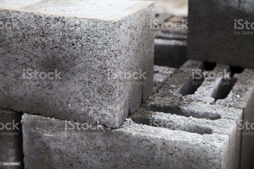 Gray building cinder blocks made of cement stacked close-up stock photo