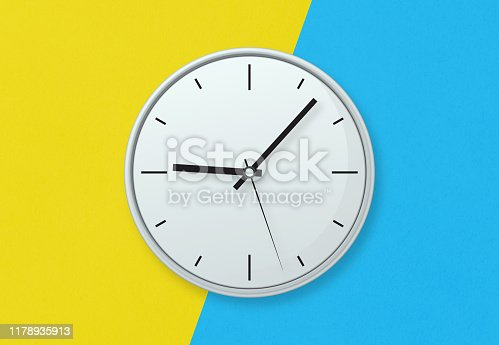 Gray clock on colourful background stock photo