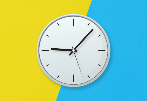 Gray clock on colorful background stock photo stock photo