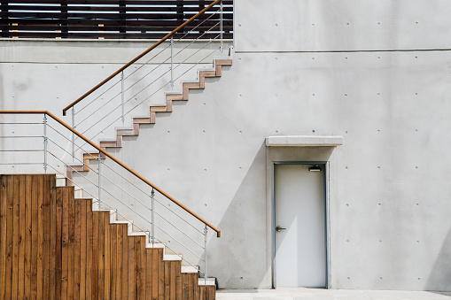 Gray color modern building exterior, stairs and door