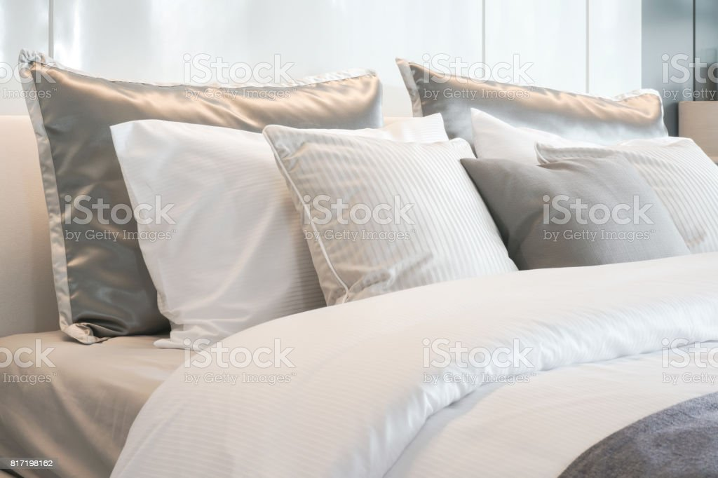 Gray Color Scheme Pillows Setting On Bed With Satin Finished Style Bedding Stock Photo Download Image Now Istock