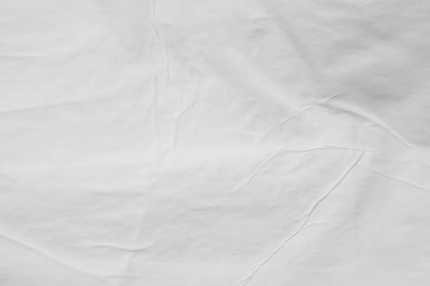 gray colored wet paper wrinkled texture background stock photo