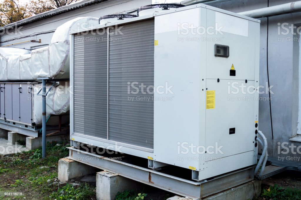 Gray commercial AC unit for central ventilation system stock photo