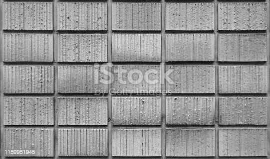 Close up shot of gray concrete cinder block wall