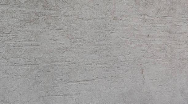 Grauer Betonwandhintergrund mit groben Mustern – Foto