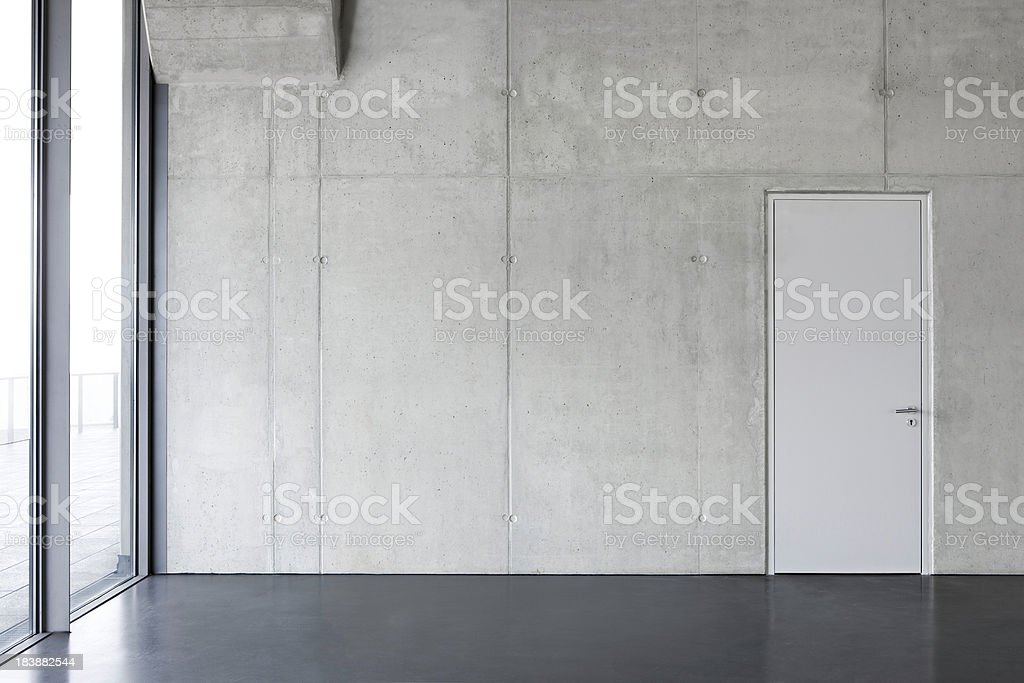 gray concrete wall with a door. stock photo