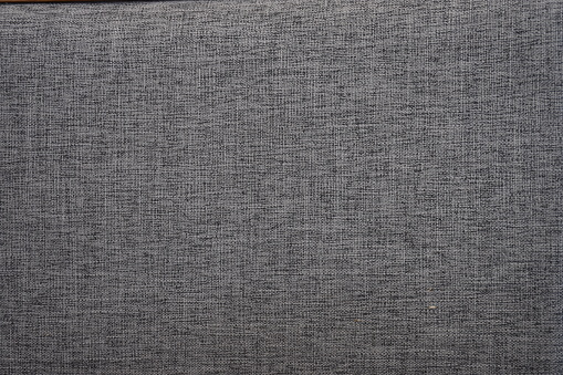 Gray cotton fabrics texture. Cotton fabrics can be very soft and comfortable hand at first touch, a texture that is soft, making it ideal stretchy and strong  for casual and relaxed garments.