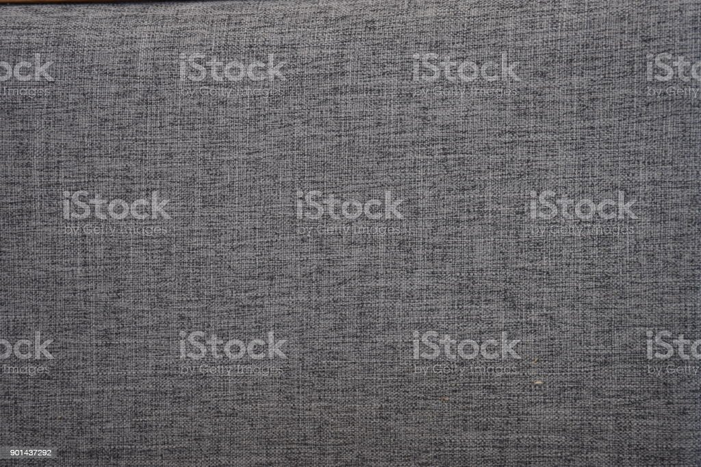Gray cotton fabrics texture. Cotton fabrics can be very soft and comfortable hand at first touch, a texture that is soft, making it ideal stretchy and strong  for casual and relaxed garments. stock photo