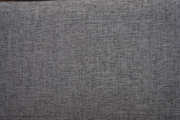 Gray cotton fabrics texture. Cotton fabrics can be very soft and comfortable hand at first touch, a texture that is soft, making it ideal stretchy and strong  for casual and relaxed garments. Gray cotton fabrics texture. Cotton fabrics can be very soft and comfortable hand at first touch, a texture that is soft, making it ideal stretchy and strong  for casual and relaxed garments. heather stock pictures, royalty-free photos & images