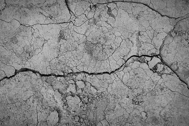 gray pęknięty betonu tekstura tło, zbliżenie - popękany zdjęcia i obrazy z banku zdjęć