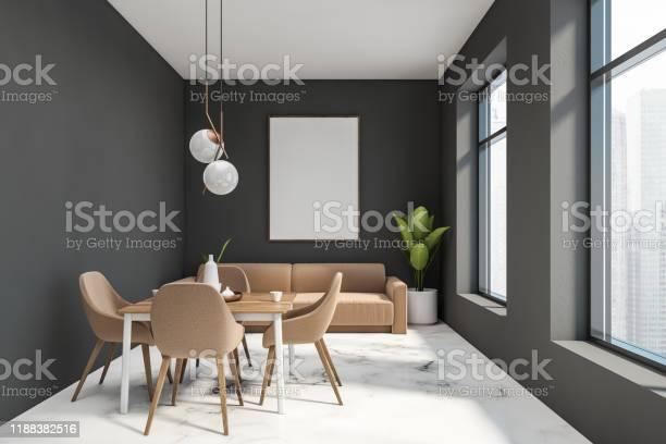 Gray dining room with beige sofa and poster picture id1188382516?b=1&k=6&m=1188382516&s=612x612&h=nzuxi9igpe00ur7rku99 pssjft ywyl6stkx qm6hw=