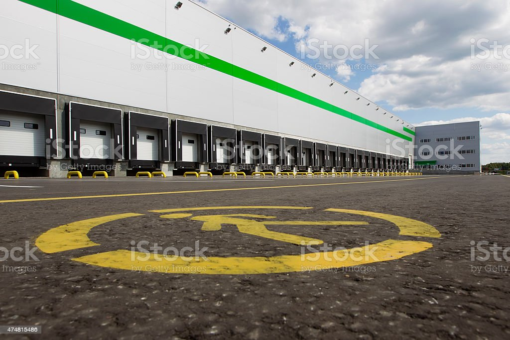 gray distribution warehouse building stock photo