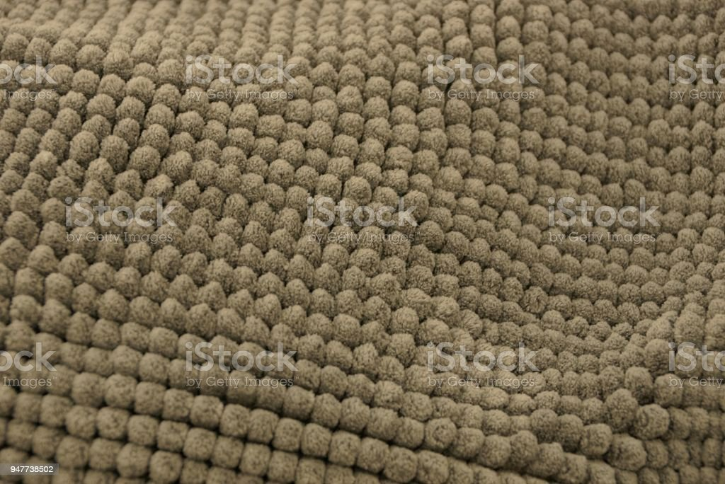 gray fabric texture of a piece of woolen carpet stock photo