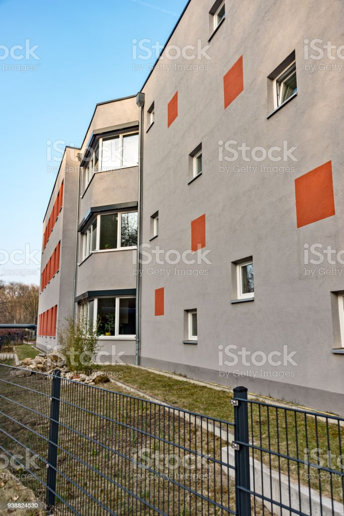 Gray facade with red accents stock photo