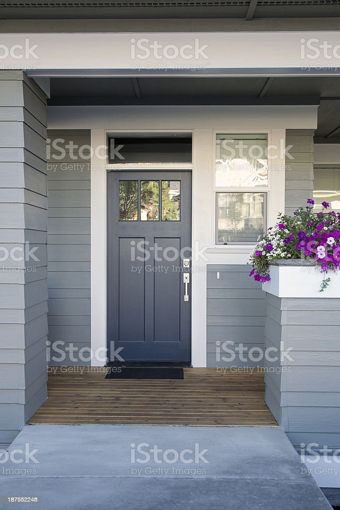 Gray front door of a home stock photo