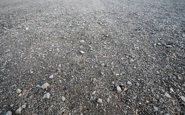 gray gravel road for backgrounds stock photo