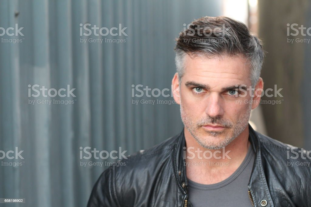 Gray haired male dressed in leather jacket stock photo