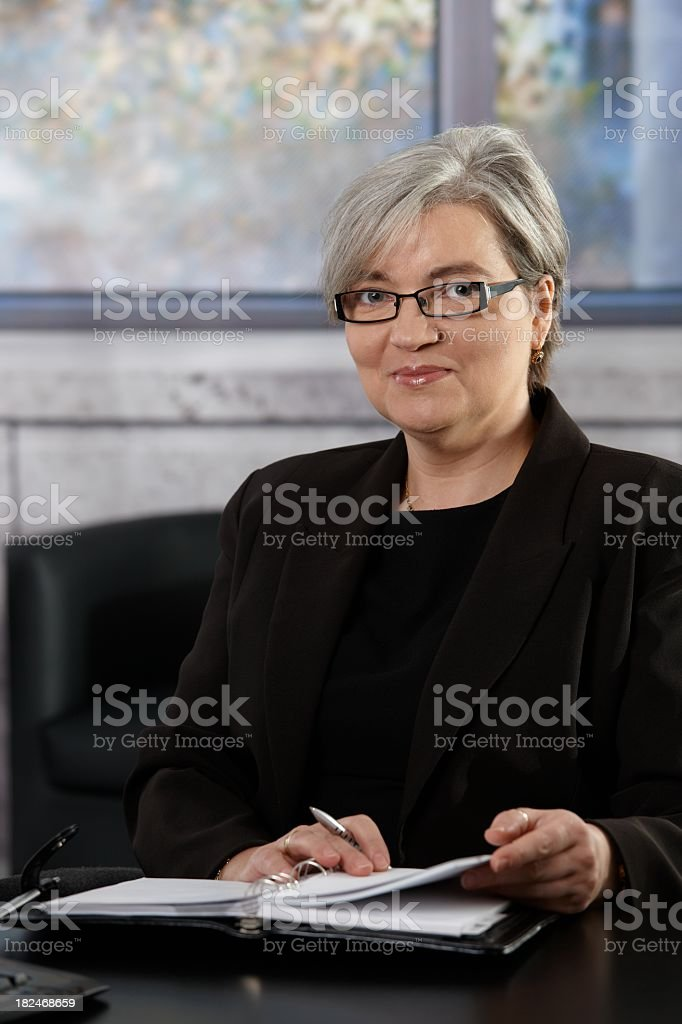 Gray haired mature businesswoman in office royalty-free stock photo