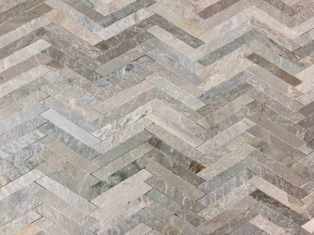 Gray herringbone stone tile pattern stock photo
