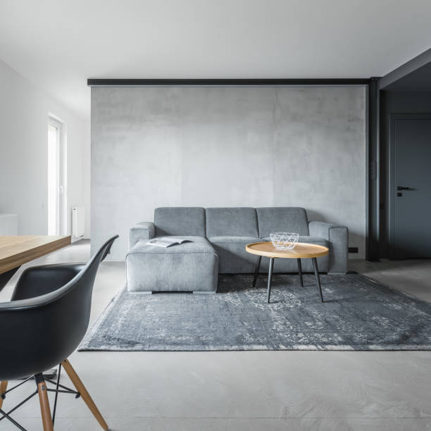 graue wohngebäude - betonboden wohnzimmer stock-fotos und bilder
