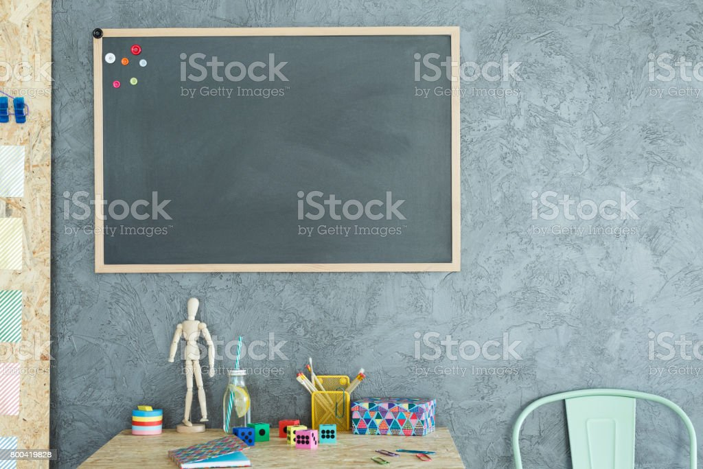 Gray home office with blackboard stock photo