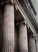 istock Gray ionic columns at the front of a traditional building 172179574