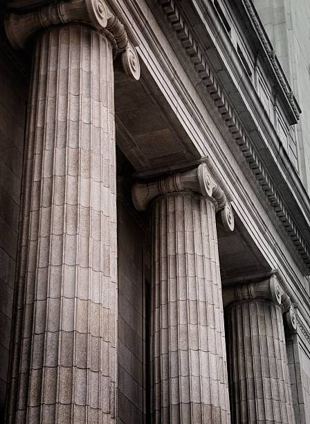 Gray ionic columns at the front of a traditional building stock photo