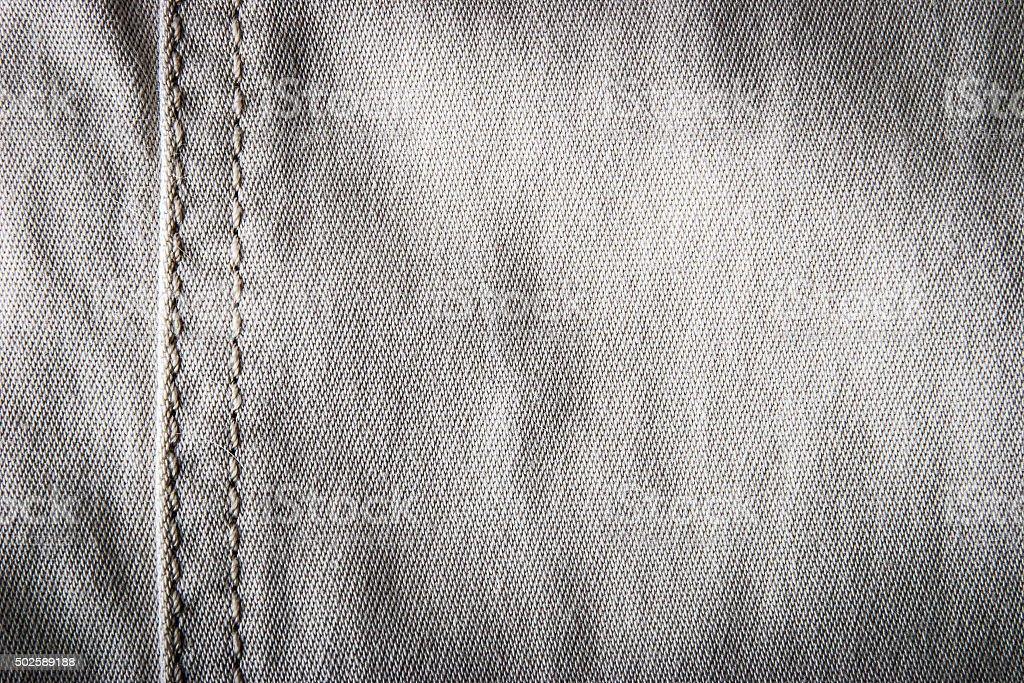 Gray jeans mit Naht-Hintergrund Lizenzfreies stock-foto