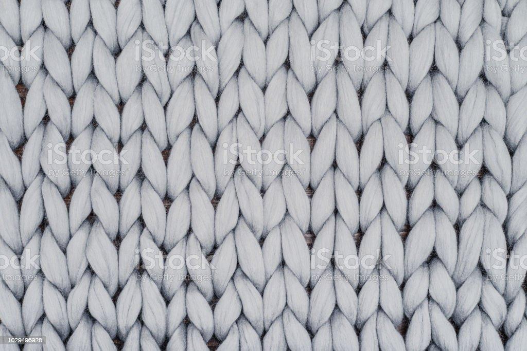 Graue gestrickte Decke aus Merinowolle – Foto