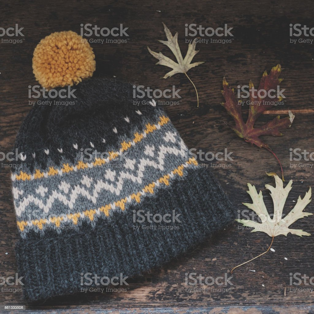 Gray knitted hat with pompon stock photo