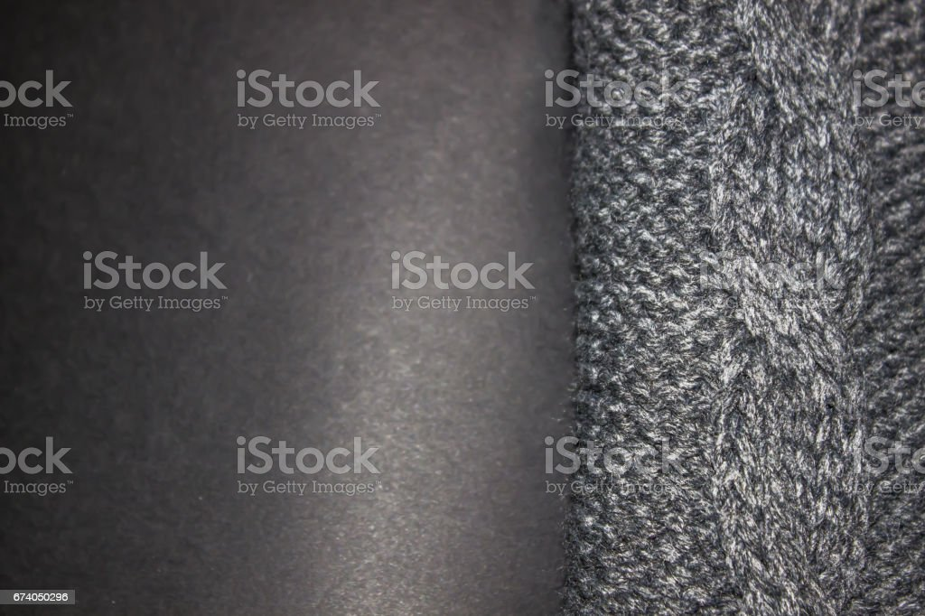 Gray knitted sweater on a black background royalty-free stock photo