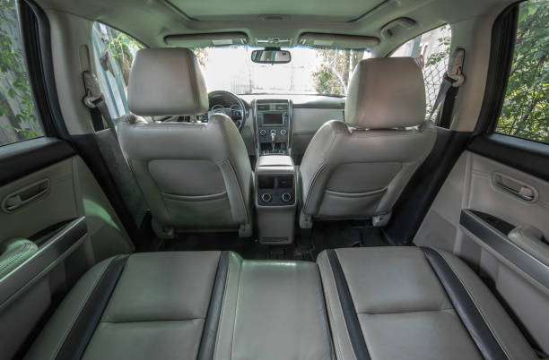 gray leather interior of car - car interior stock photos and pictures