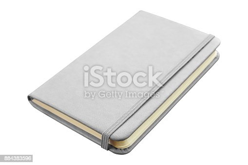 Gray leather notebook with elastic band closure isolated on white background.