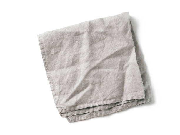 Gray linen napkin isolated on white stock photo