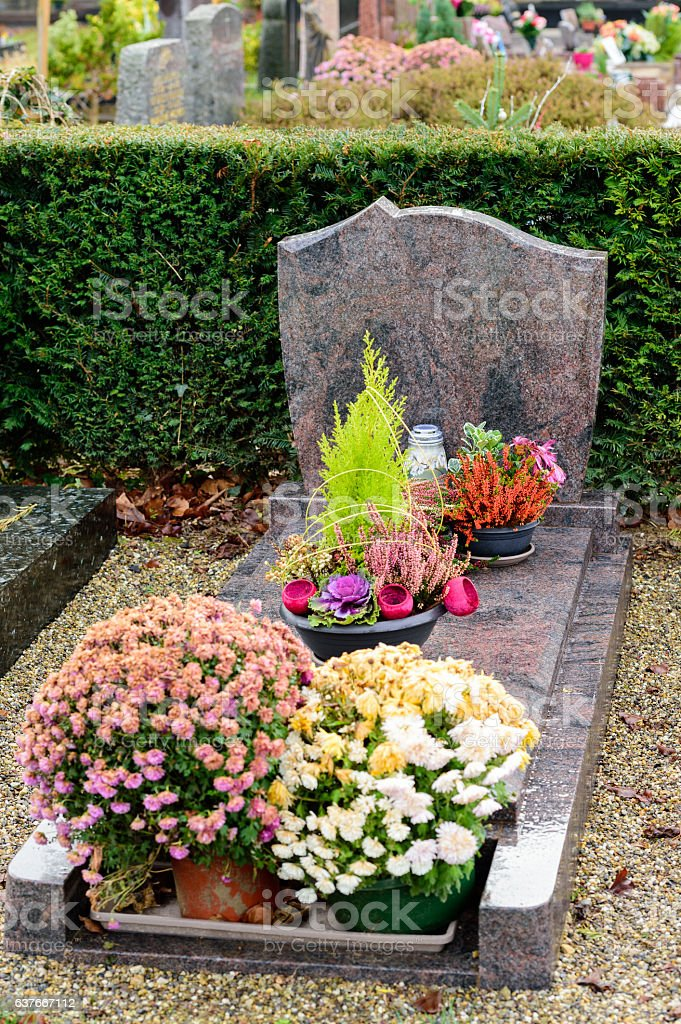Gray marble tombstones in French cemetery stock photo