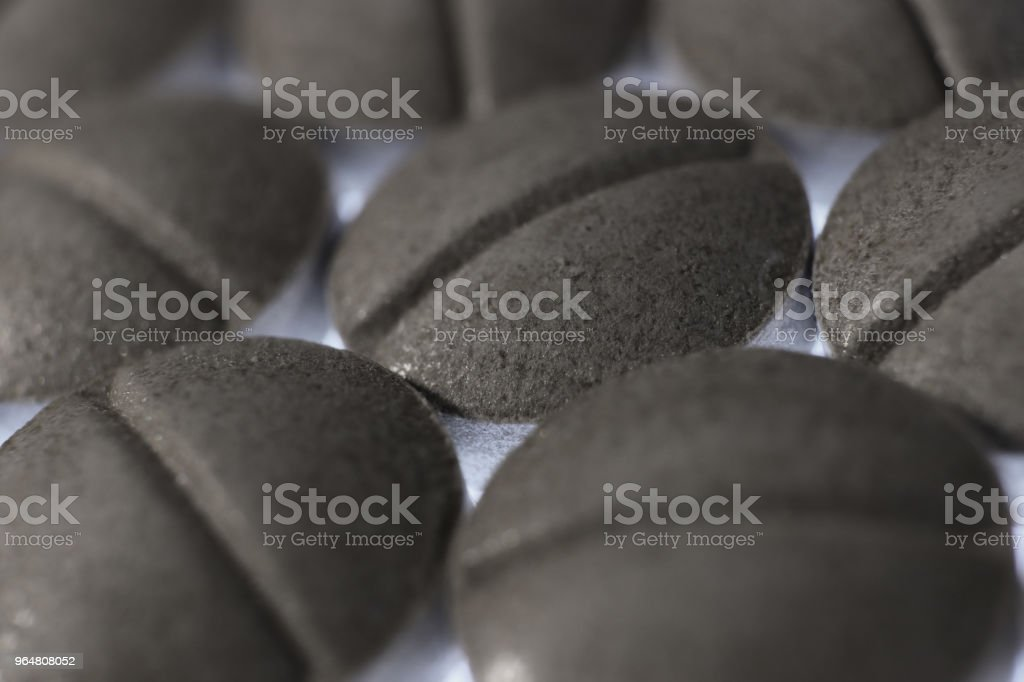Gray Medicine Tablets Handful. Pharmacy Pills Background. Macro Closeup. royalty-free stock photo