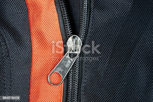 175597083 istock photo gray metal buckle on a black red backpack 994518426