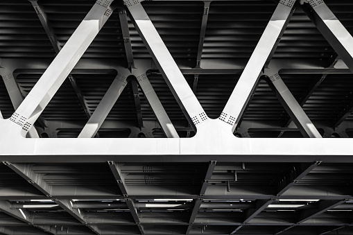 Gray metal framework of the bridge. Industrial construction