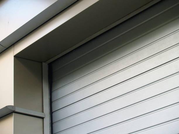 Gray metal roller gate - foto stock