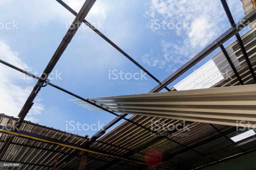 Gray Metal sheets Roofing are installed. stock photo