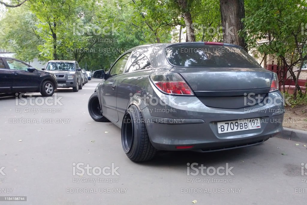 Gray metallic Opel Astra modified to Stance style. Car with big...