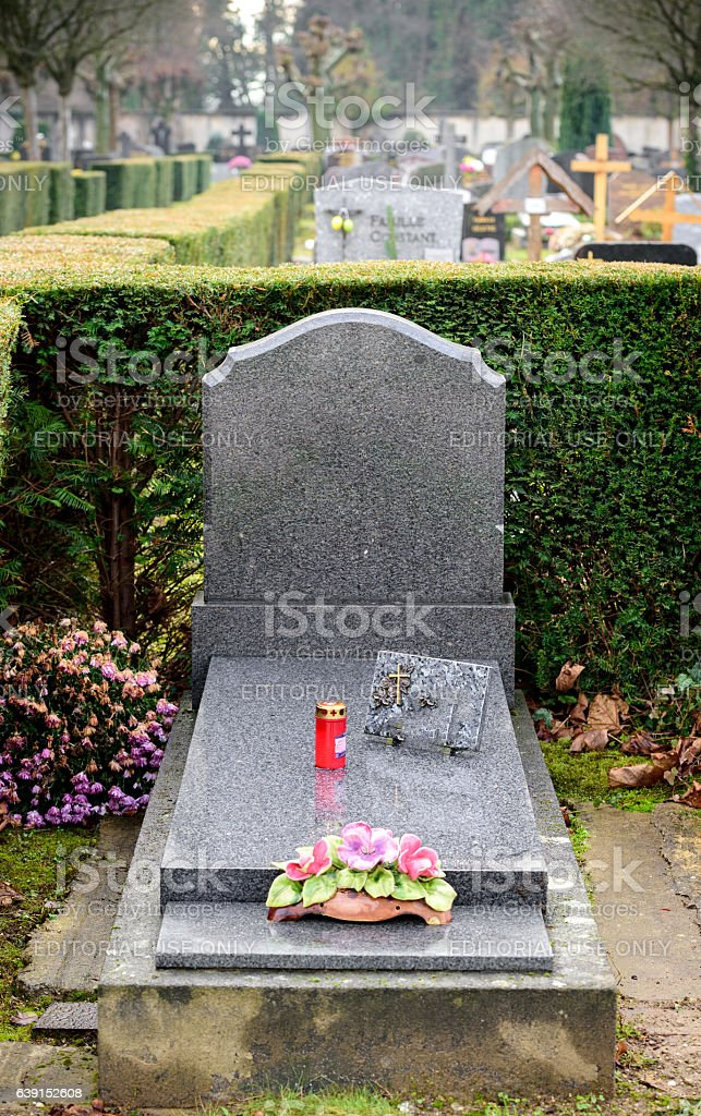 Gray modern Marble tombstones in French cemetery stock photo